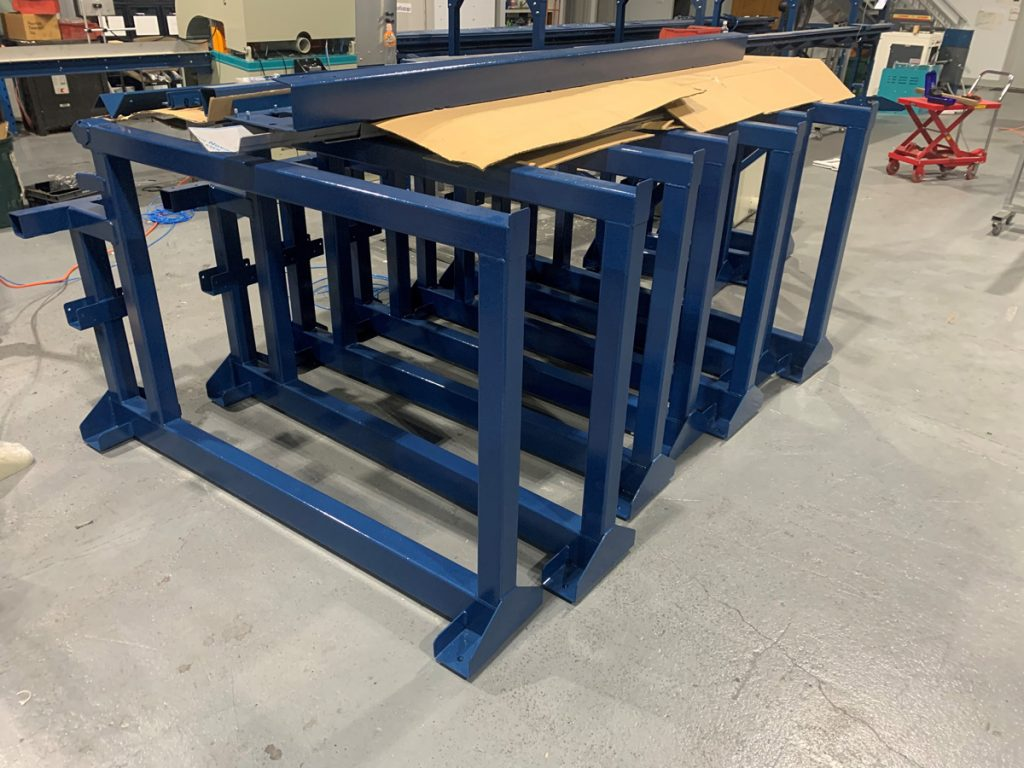 Loading frames for automatic cutting saw
